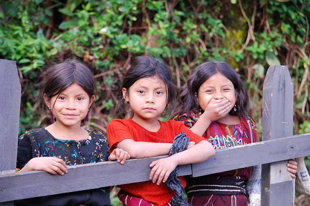 Ixil Mayan girls pose for a photo in Guatemala. / USAID